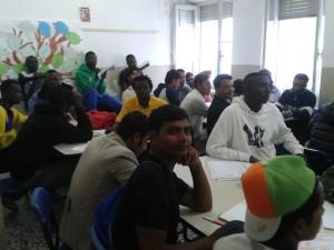 migranti bione lezione italiano